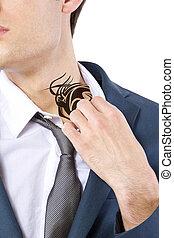 Hidden Tattoo - young caucasian businessman revealing a...
