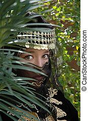 Hidden Treasure - Mysterious girl all in black partially ...