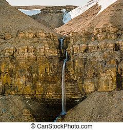 Hidden waterfall high Arctic