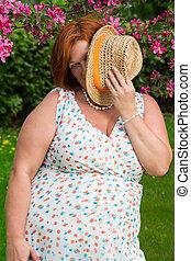 Hidding behind a hat