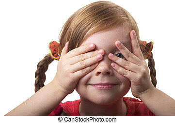 Hide and seek - Little girl peeping through hand with one...