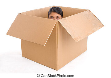 Hiding - A young woman hiding inside a box, shot on white...
