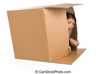 Hiding - A young woman is hiding inside a box and...