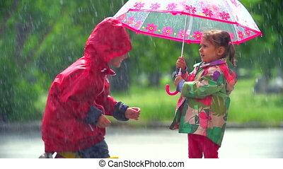 Girl letting boy under her umbrella