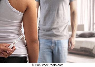 Hiding pregnancy test from spouse - Woman hiding positive...