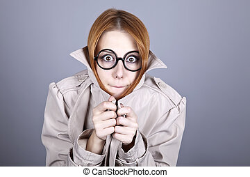 Hiding red-haired girl in glasses and cloak.