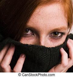 hiding redhead - Studio portrait of a natural redhead hiding...