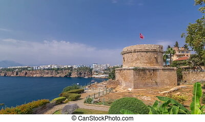 Hidirlik tower in Kas town in Antalya timelapse hyperlapse with view of harbor marine bay is a old city