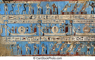 Hieroglyphic carvings in ancient egyptian temple -...
