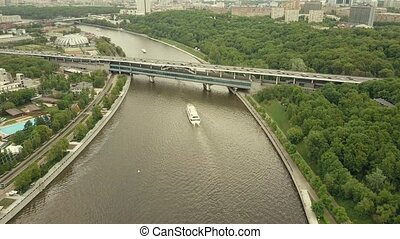 High altitude aerial shot of Moscow river tour boats, cars...