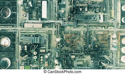 High altitude aerial top down view of big oil refinery -...