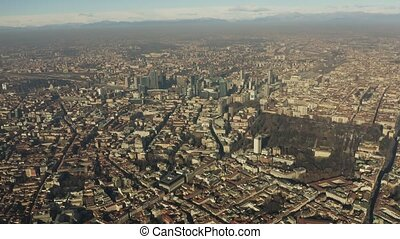 High altitude aerial view of Milan cityscape