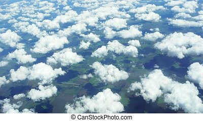 Overlooking View of Cumulous Clouds from Thirty Thousand Feet