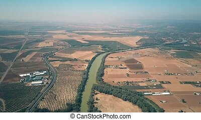 High altitude aerial view of the Guadalquivir river and...