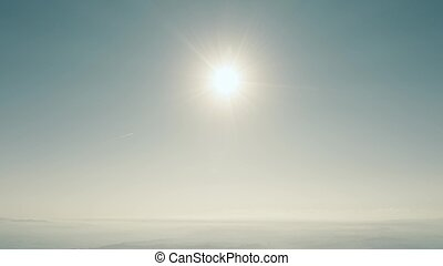 High altitude aerial view of the sun and clear blue sky