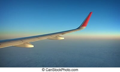 High Altitude Airborne Shot of an Airplane Wing over a...