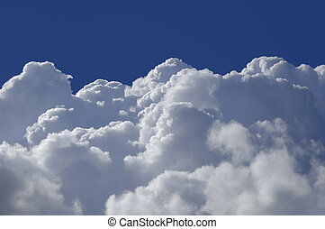 High Altitude Clouds - Cumulus clouds shot from a high...
