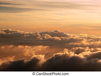high altitude cloudscape - sunrise over high altitude clouds...