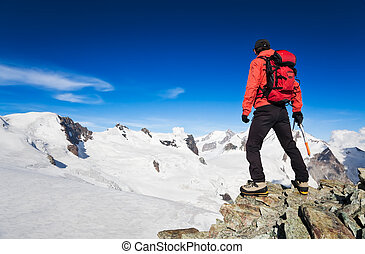 High Altitude Hiking - Male hiker standing in front of Monte...