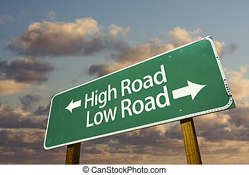 High and Low Road Green Road Sign with dramatic blue sky and...