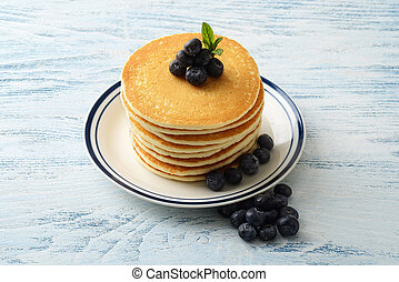 high angle blueberry pancakes on a plate
