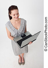 High angle of a beautiful businesswoman using a laptop