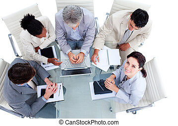 High angle of a multi-ethnic business people in a meeting