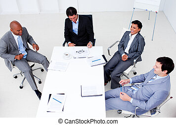 High angle of business group showing ethnic diversity in a meeting