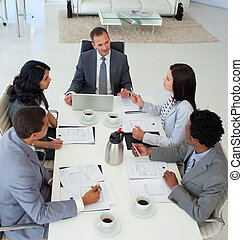 High angle of business people discussing in office a plan