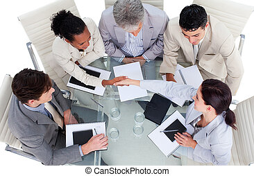 High angle of business people shaking hands in a meeting