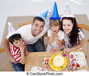 High angle of happy family celebrating a birthday at home