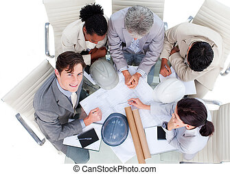 High angle of international architects in a meeting