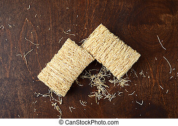 shredded wheat cereal on wood table - high angle of shredded...