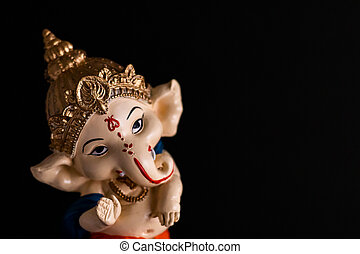 high angle photography of beautiful ganesha statue on black background. culture and hindu concept