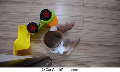 High Angle shot, cute seven months old baby boy playing with educational toys on the floor