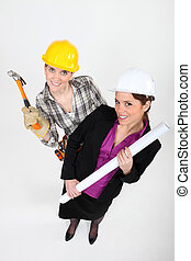 High-angle shot of a tradeswoman standing next to an engineer