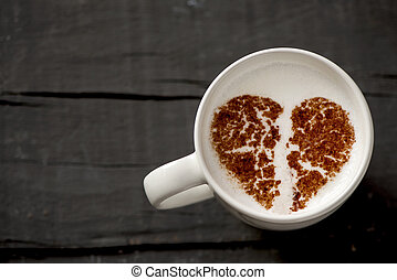 cup of cappuccino with a broken heart