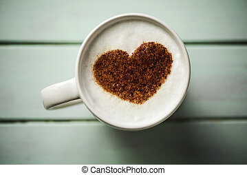 cup of cappuccino with a heart