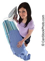 High-angle shot of a woman ironing