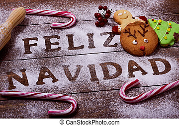 text feliz navidad, merry christmas in spanish - high-angle...