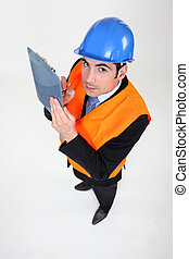 high angle shot of architect holding clipboard