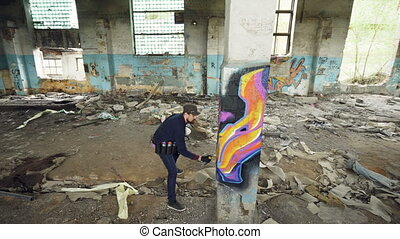 High angle shot of young urban painter creating abstract...