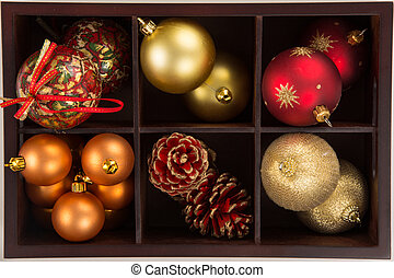 High angle view of a box of a collection of Christmas balls