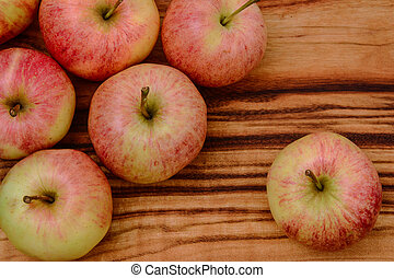 closeup of apples on a wooden board