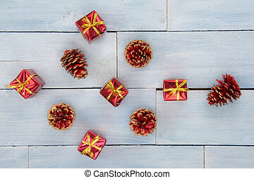 High angle view of a collection of Christmas ornaments on a wooden background