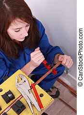 high-angle view of a female plumber