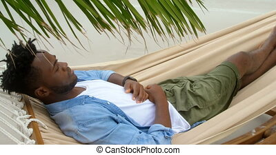 High angle view of African american man sleeping in a ...