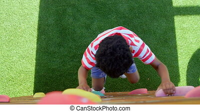High angle view of African American schoolboy playing in ...