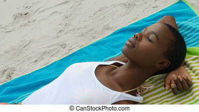 High angle view of African american woman sleeping on the ...