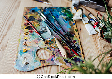 Palette knife or spatula, brushes and paint tube  Fine art